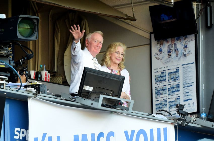 LOS ANGELES, CA - SEPTEMBER 25: Los Angeles Dodgers announcer Vin Scully and his wife Sandra Hunt acknowedge the crowds applause for his 67 years of service after a 4-3 win over the Colorado Rockies at Dodger Stadium on September 25, 2016 in Los Angeles, California. This was Scully's final home game as he will retire at the end of the season. (Photo by Harry How/Getty Images)