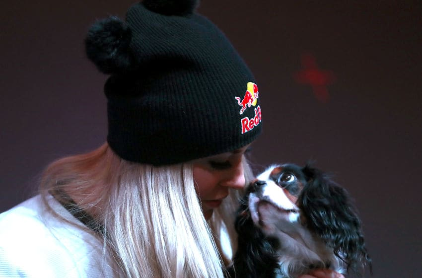 ST MORITZ, SWITZERLAND - FEBRUARY 05: Lindsey Vonn of USA and her dog Lucy during a press conference at Hotel Reine Victoria ahead of the FIS Alpine World Ski Championships on February 5, 2017 in St Moritz, Switzerland. (Photo by Alexander Hassenstein/Getty Images)