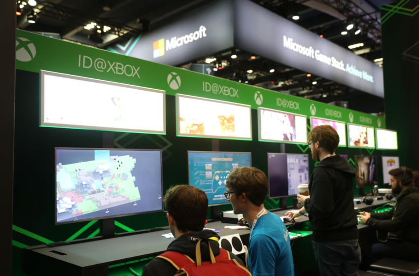 SAN FRANCISCO, CALIFORNIA - MARCH 20: Attendees play with the Microsoft Xbox at the Microsoft booth at the 2019 GDC Game Developers Conference on March 20, 2019 in San Francisco, California. The GDC runs through March 22. (Photo by Justin Sullivan/Getty Images)