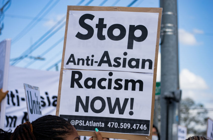 ATLANTA, GA - MARCH 18: Activists demonstrate against violence towards women and Asians following Tuesday night's shootings on March 18, 2021 in Atlanta, Georgia. Suspect Robert Aaron Long, 21, was arrested after a series of shootings at three Atlanta-area spas left eight people dead, including six Asian women. (Photo by Megan Varner/Getty Images)