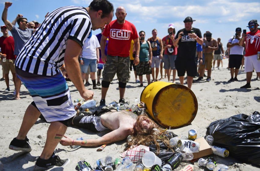 ATLANTIC CITY, NJ - JUNE 30: GCW wrestlers Steve Sanders (bottom) is slow to get up as Nick Gage (back) looks on with a referee officiating during the second and final day of Warped Tour on June 30, 2019 in Atlantic City, New Jersey. (Photo by Corey Perrine/Getty Images)