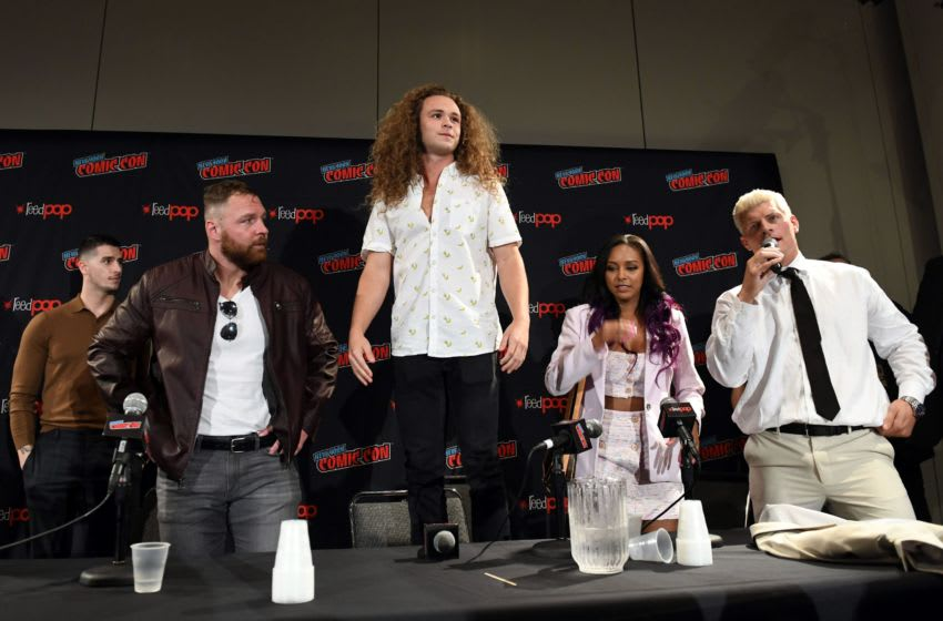 NEW YORK, NEW YORK - OCTOBER 04: (L-R) Jon Moxley, Jack Perry aka Jungle Boy, Brandi Rhodes, and Cody Rhodes attends the All Elite Wrestling panel during 2019 New York Comic Con at Jacob Javits Center on October 04, 2019 in New York City. (Photo by Noam Galai/Getty Images for WarnerMedia Company)