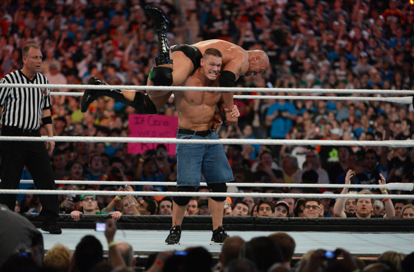 MIAMI GARDENS, FL - APRIL 1: Dwayne ''The Rock'' Johnson and John Cena in action during WrestleMania XXVIII at Sun Life Stadium on April 1, 2012 in Miami Gardens, Florida. (Photo by Ron Elkman/Sports Imagery/Getty Images)