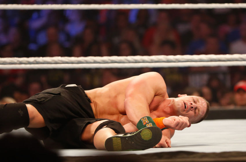 NEW YORK, NY - AUGUST 23: John Cena recovers from a blow during his fight against Seth Rollins at the WWE SummerSlam 2015 at Barclays Center of Brooklyn on August 23, 2015 in New York City. (Photo by JP Yim/Getty Images)