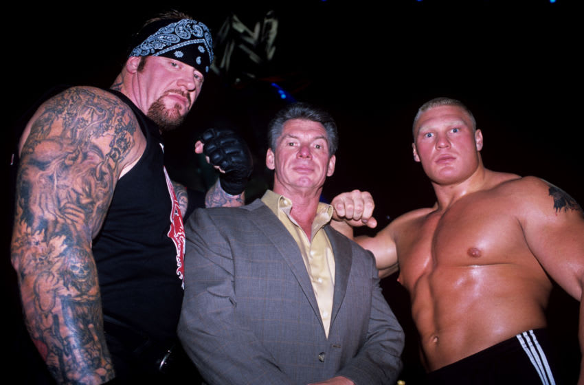 WWE Owner Vincent Kennedy McMahon (c) flanked by superstars The Undertaker (l) and Brock Lesnar (r) (Photo by Simon Galloway - PA Images via Getty Images)