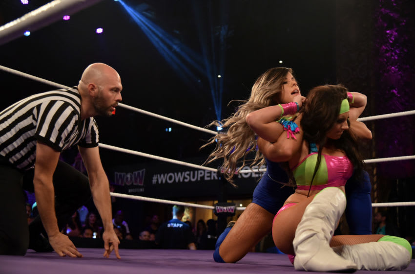 LOS ANGELES, CA - MAY 11: Wrestlers Santana Garrett (R) and Abilene Maverick battle it out at the Women of Wrestling Championship Fight at Belasco Theatre on May 11, 2017 in Los Angeles, California. (Photo by Brandon Williams/Getty Images)