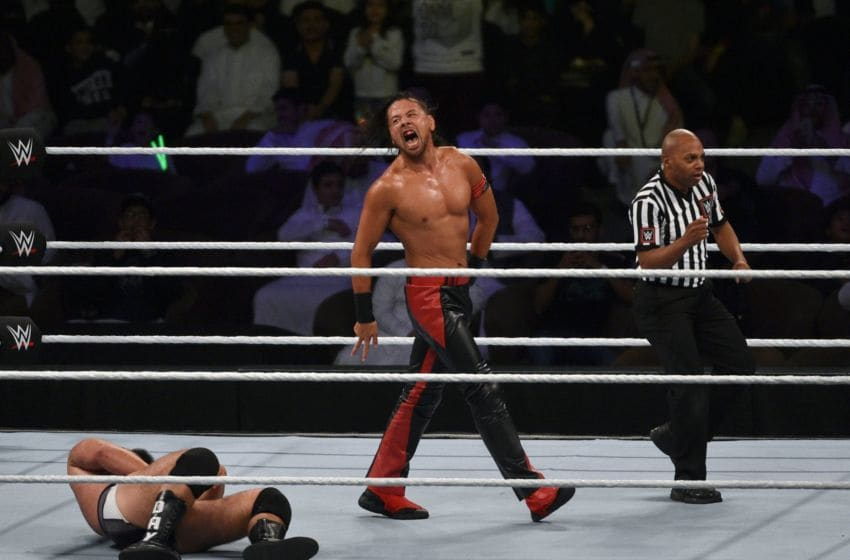 Shinsuke Nakamura (C) celebrates after defeating Rusev (L) for the for the WWE United States Championship during the World Wrestling Entertainment (WWE) Crown Jewel pay-per-view at the King Saud University Stadium in Riyadh on November 2, 2018. (Photo by Fayez Nureldine / AFP) (Photo credit should read FAYEZ NURELDINE/AFP/Getty Images)