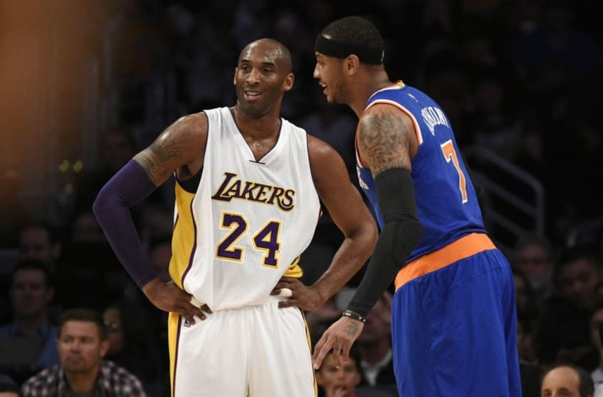 Mar 13, 2016; Los Angeles, CA, USA; Los Angeles Lakers forward Kobe Bryant (24) talks with New York Knicks forward Carmelo Anthony (right) during the first quarter at Staples Center. Mandatory Credit: Kelvin Kuo-USA TODAY Sports