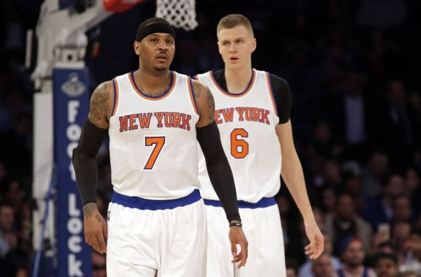 Feb 2, 2016; New York, NY, USA; New York Knicks forward Carmelo Anthony (7) and forward Kristaps Porzingis (6) against the Boston Celtics during the first half of an NBA basketball game at Madison Square Garden. Mandatory Credit: Adam Hunger-USA TODAY Sports