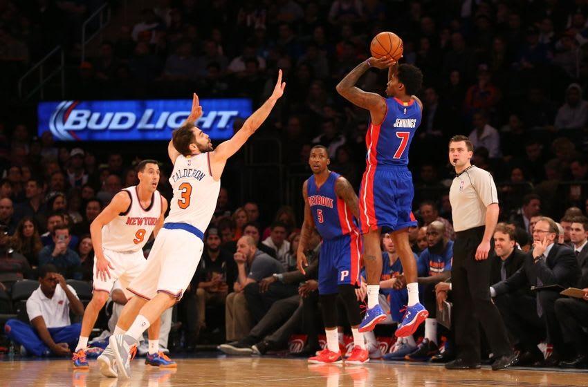Jan 2, 2015; New York, NY, USA; Detroit Pistons guard Brandon Jennings (7) shoots for three over New York Knicks guard Jose Calderon (3) during the third quarter at Madison Square Garden. Detroit Pistons won 97-81. Mandatory Credit: Anthony Gruppuso-USA TODAY Sports