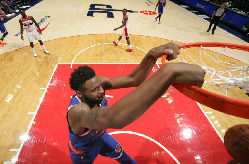 WASHINGTON, DC - OCTOBER 01: Mitchell Robinson #26 of the New York Knicks goes in for the dunk against the Washington Wizards during a pre-season game on October 1, 2018 at Capital One Arena in Washington, DC. NOTE TO USER: User expressly acknowledges and agrees that, by downloading and/or using this photograph, user is consenting to the terms and conditions of the Getty Images License Agreement. Mandatory Copyright Notice: Copyright 2018 NBAE (Photo by Ned Dishman/NBAE via Getty Images)