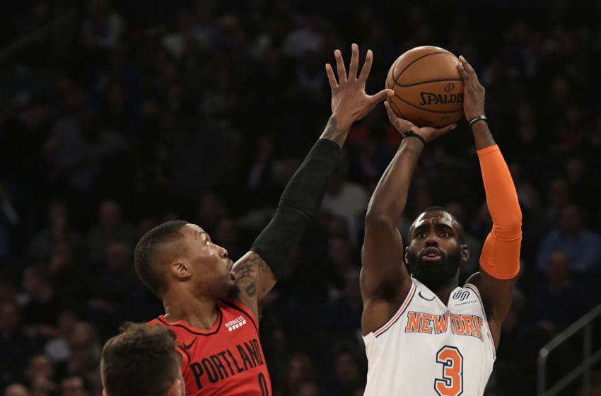 NEW YORK, NEW YORK - NOVEMBER 20: Tim Hardaway Jr. #3 of the New York Knicks attempts a shot against defense from Damian Lillard #0 of the Portland Trail Blazers during the first quarter of the game at Madison Square Garden on November 20, 2018 in New York City. NOTE TO USER: User expressly acknowledges and agrees that, by downloading and or using this photograph, User is consenting to the terms and conditions of the Getty Images License Agreement. (Photo by Sarah Stier/Getty Images)