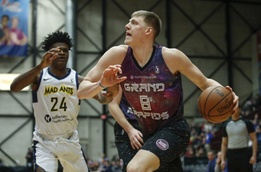GRAND RAPIDS, MI - FEBRUARY 2: Henry Ellenson #8 of the Grand Rapids Drive drives to the basket against Alize Johnson #24 of the Fort Wayne Mad Ants during the first half of an NBA G-League game on February 2, 2019 at DeltaPlex Arena in Grand Rapids, Michigan. NOTE TO USER: User expressly acknowledges and agrees that, by downloading and or using this photograph, User is consenting to the terms and conditions of the Getty Images License Agreement. Mandatory Copyright Notice: Copyright 2019 NBAE (Photo by Kamil Krzaczynski/NBAE via Getty Images)
