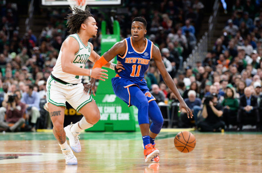 BOSTON, MA - NOVEMBER 1: Frank Ntilikina #11 of the New York Knicks is defended by Carsen Edwards #4 of the Boston Celtics in the first half at TD Garden on November 1, 2019 in Boston, Massachusetts. NOTE TO USER: User expressly acknowledges and agrees that, by downloading and or using this photograph, User is consenting to the terms and conditions of the Getty Images License Agreement. (Photo by Kathryn Riley/Getty Images)