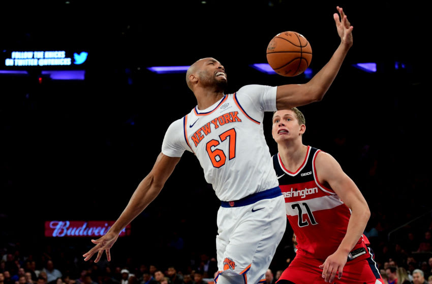 NEW YORK, NEW YORK - OCTOBER 11: Moritz Wagner #21 of the Washington Wizards watches as Taj Gibson #67 of the New York Knicks tries to control the ball during their game at Madison Square Garden on October 11, 2019 in New York City. NOTE TO USER: User expressly acknowledges and agrees that, by downloading and or using this photograph, User is consenting to the terms and conditions of the Getty Images License Agreement. (Photo by Emilee Chinn/Getty Images)
