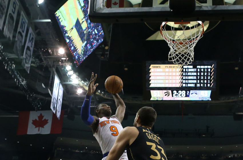 TORONTO, ON- NOVEMBER 27 - New York Knicks forward RJ Barrett (9) dunks over Toronto Raptors center Marc Gasol (33) as the Toronto Raptors play the New York Knicks at Scotiabank Arena in Toronto. November 27, 2019. (Steve Russell/Toronto Star via Getty Images)