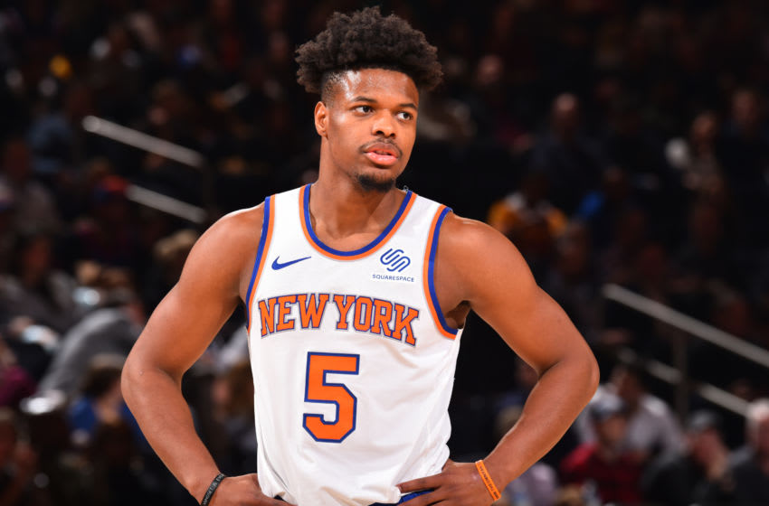 NEW YORK, NY - NOVEMBER 29: Dennis Smith Jr. #5 of the New York Knicks looks on during a game against the Philadelphia 76ers on November 29, 2019 at Madison Square Garden in New York City, New York. NOTE TO USER: User expressly acknowledges and agrees that, by downloading and or using this photograph, User is consenting to the terms and conditions of the Getty Images License Agreement. Mandatory Copyright Notice: Copyright 2019 NBAE (Photo by Jesse D. Garrabrant/NBAE via Getty Images)