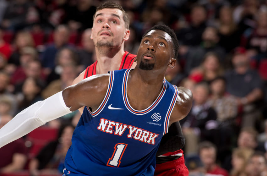 PORTLAND, OR - DECEMBER 10: Bobby Portis #1 of the New York Knicks fights for the rebound against the Portland Trail Blazers on December 10, 2019 at the Moda Center Arena in Portland, Oregon. NOTE TO USER: User expressly acknowledges and agrees that, by downloading and or using this photograph, user is consenting to the terms and conditions of the Getty Images License Agreement. Mandatory Copyright Notice: Copyright 2019 NBAE (Photo by Cameron Browne/NBAE via Getty Images)