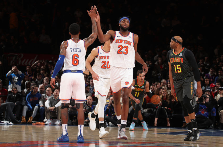 NEW YORK, NY - December 17: Elfrid Payton #6 and Mitchell Robinson #23 of the New York Knicks hi-five during a game against the Atlanta Hawks on December 17, 2019 at Madison Square Garden in New York City, New York. NOTE TO USER: User expressly acknowledges and agrees that, by downloading and or using this photograph, User is consenting to the terms and conditions of the Getty Images License Agreement. Mandatory Copyright Notice: Copyright 2019 NBAE (Photo by Nathaniel S. Butler/NBAE via Getty Images)