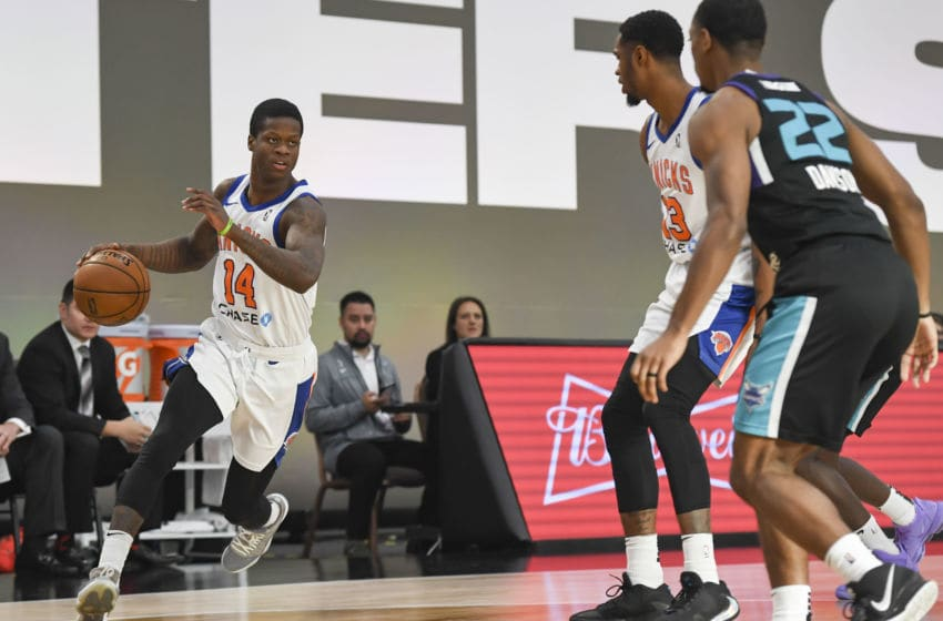 LAS VEGAS, NV - DECEMBER 19: Amir Hinton #14 of the Westchester Knicks handles the ball against the Greensboro Swarm during the NBA G League Winter Showcase at Mandalay Bay Events Center in Las Vegas, Nevada on December 20, 2019. NOTE TO USER: User expressly acknowledges and agrees that, by downloading and/or using this photograph, user is consenting to the terms and conditions of the Getty Images License Agreement. Mandatory Copyright Notice: Copyright 2019 NBAE (Photo by Todd Lussier/NBAE via Getty Images)