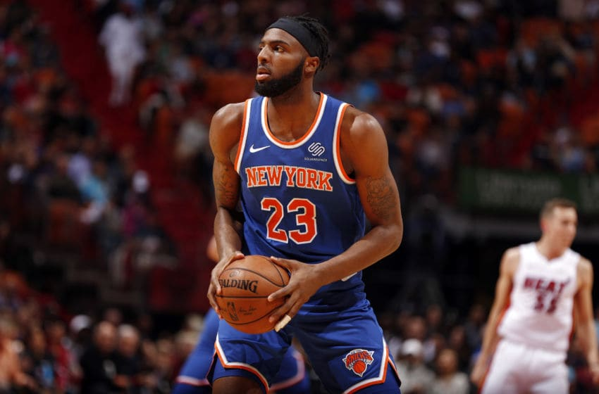 MIAMI, FL - DECEMBER 20: Mitchell Robinson #23 of the New York Knicks handles the ball during the game against the Miami Heat on December 20, 2019 at American Airlines Arena in Miami, Florida. NOTE TO USER: User expressly acknowledges and agrees that, by downloading and or using this Photograph, user is consenting to the terms and conditions of the Getty Images License Agreement. Mandatory Copyright Notice: Copyright 2019 NBAE (Photo by Issac Baldizon/NBAE via Getty Images)