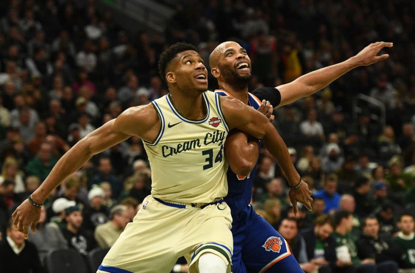 MILWAUKEE, WISCONSIN - DECEMBER 02: Giannis Antetokounmpo #34 of the Milwaukee Bucks works against Taj Gibson #67 of the New York Knicks during the second half at Fiserv Forum on December 02, 2019 in Milwaukee, Wisconsin. NOTE TO USER: User expressly acknowledges and agrees that, by downloading and or using this photograph, User is consenting to the terms and conditions of the Getty Images License Agreement. (Photo by Stacy Revere/Getty Images)