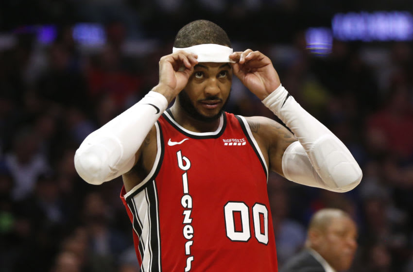 LOS ANGELES, CALIFORNIA - DECEMBER 03: Carmelo Anthony #00 of the Portland Trail Blazers adjusts his headband during a game against the Los Angeles Clippers at Staples Center on December 03, 2019 in Los Angeles, California. NOTE TO USER: User expressly acknowledges and agrees that, by downloading and or using this photograph, User is consenting to the terms and conditions of the Getty Images License Agreement. (Photo by Katharine Lotze/Getty Images)