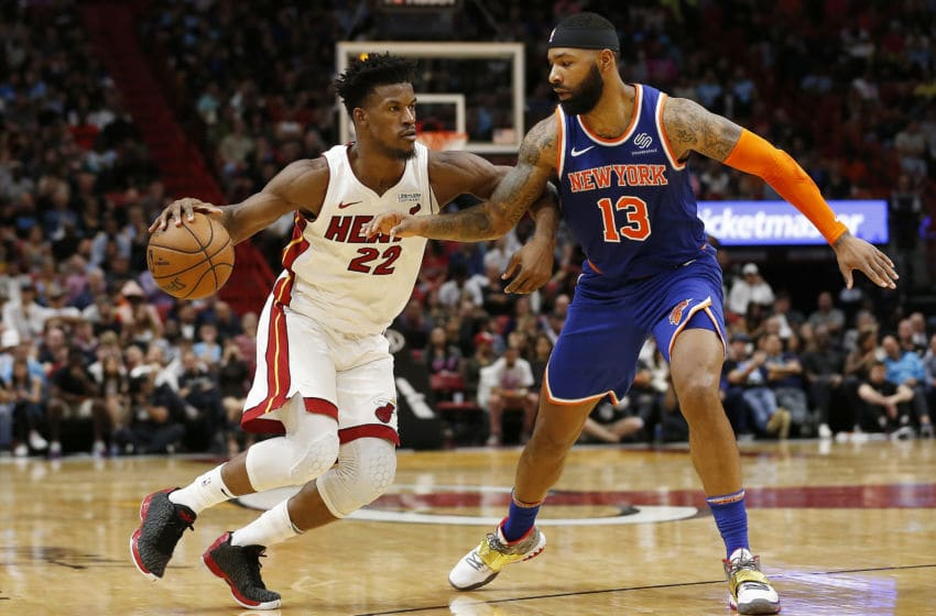 MIAMI, FLORIDA - DECEMBER 20: Jimmy Butler #22 of the Miami Heat drives to the basket against Marcus Morris Sr. #13 of the New York Knicks during the second half at American Airlines Arena on December 20, 2019 in Miami, Florida. NOTE TO USER: User expressly acknowledges and agrees that, by downloading and/or using this photograph, user is consenting to the terms and conditions of the Getty Images License Agreement. (Photo by Michael Reaves/Getty Images)