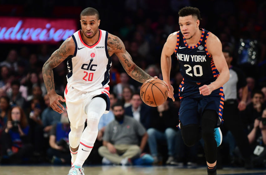 NEW YORK, NEW YORK - DECEMBER 23: Gary Payton II #20 of the Washington Wizards drives past Kevin Knox II #20 of the New York Knicks during the first half of their game at Madison Square Garden on December 23, 2019 in New York City. NOTE TO USER: User expressly acknowledges and agrees that, by downloading and or using this photograph, User is consenting to the terms and conditions of the Getty Images License Agreement. (Photo by Emilee Chinn/Getty Images)