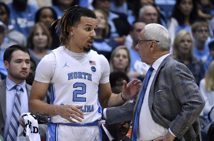 CHAPEL HILL, NORTH CAROLINA - FEBRUARY 01: Cole Anthony #2 talks with head coach Roy Williams of the North Carolina Tar Heels during the first half of their game against the Boston College Eaglesat the Dean Smith Center on February 01, 2020 in Chapel Hill, North Carolina. (Photo by Grant Halverson/Getty Images)