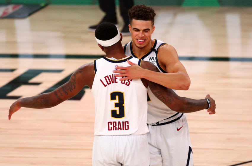 LAKE BUENA VISTA, FLORIDA - AUGUST 3: Michael Porter Jr. #1 and Torrey Craig #3 of the Denver Nuggets celebrate after defeating the Oklahoma City Thunder in overtime in a NBA basketball game against the Denver Nuggets at The Arena. Mandatory Credit: Kim Klement-USA TODAY Sports shoots the ball during the fourth quarter in a NBA basketball game at The Arena at ESPN Wide World Of Sports Complex on August 3, 2020 in Lake Buena Vista, Florida. NOTE TO USER: User expressly acknowledges and agrees that, by downloading and or using this photograph, User is consenting to the terms and conditions of the Getty Images License Agreement. (Photo by Kim Klement - Pool/Getty Images)
