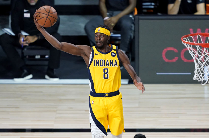LAKE BUENA VISTA, FLORIDA - AUGUST 14: Justin Holiday #8 of the Indiana Pacers rebounds against the Miami Heat during the first half of an NBA basketball game at AdventHealth Arena at ESPN Wide World Of Sports Complex on August 14, 2020 in Lake Buena Vista, Florida. NOTE TO USER: User expressly acknowledges and agrees that, by downloading and or using this photograph, User is consenting to the terms and conditions of the Getty Images License Agreement. (Photo by Kim Klement - Pool/Getty Images)