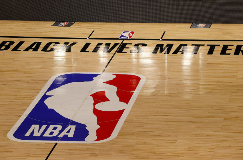 LAKE BUENA VISTA, FLORIDA - AUGUST 27: The Black Lives Matter logo is seen on an empty court as all NBA playoff games were postponed today during the 2020 NBA Playoffs at AdventHealth Arena at ESPN Wide World Of Sports Complex on August 27, 2020 in Lake Buena Vista, Florida. NBA players have reportedly decided to resume the season after their walkout of playoff games on Wednesday to protest the shooting of Jacob Blake in Kenosha, Wisconsin. (Photo by Kevin C. Cox/Getty Images)