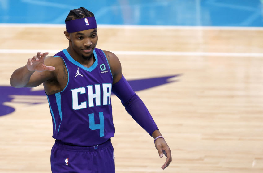 CHARLOTTE, NORTH CAROLINA - JANUARY 09: Devonte' Graham #4 of the Charlotte Hornets reacts during the fourth quarter of their game against the Atlanta Hawks at Spectrum Center on January 09, 2021 in Charlotte, North Carolina. NOTE TO USER: User expressly acknowledges and agrees that, by downloading and or using this photograph, User is consenting to the terms and conditions of the Getty Images License Agreement. (Photo by Jared C. Tilton/Getty Images)