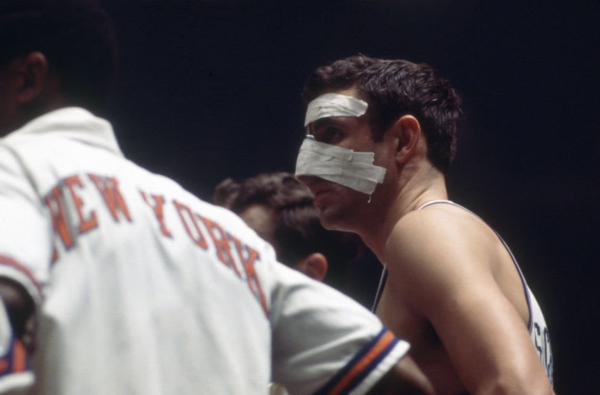 NEW YORK - CIRCA 1970: Dave DeBusschere #22 of the New York Knicks looks on while there's a break in the action during an NBA basketball game circa 1970 at Madison Square Garden in the Manhattan borough of New York City. DeBusschere played for the Knicks from 1968-74. (Photo by Focus on Sport/Getty Images)