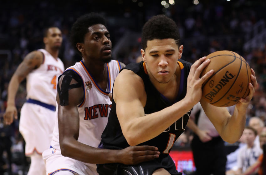 Devin Booker is fouled by the New York Knicks (Photo by Christian Petersen/Getty Images)