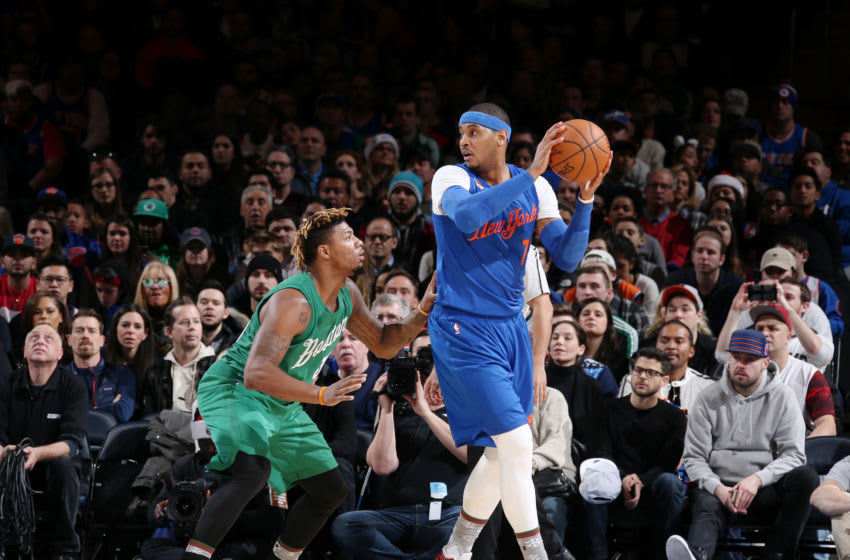 NEW YORK CITY - DECEMBER 25: Carmelo Anthony #7 of the New York Knicks looks to drive during a game against Marcus Smart #36 of the Boston Celtics on December 25, 2016 at Madison Square Garden in New York, New York. NOTE TO USER: User expressly acknowledges and agrees that, by downloading and/or using this Photograph, user is consenting to the terms and conditions of the Getty Images License Agreement. Mandatory Copyright Notice: Copyright 2016 NBAE (Photo by Nathaniel S. Butler/NBAE via Getty Images)