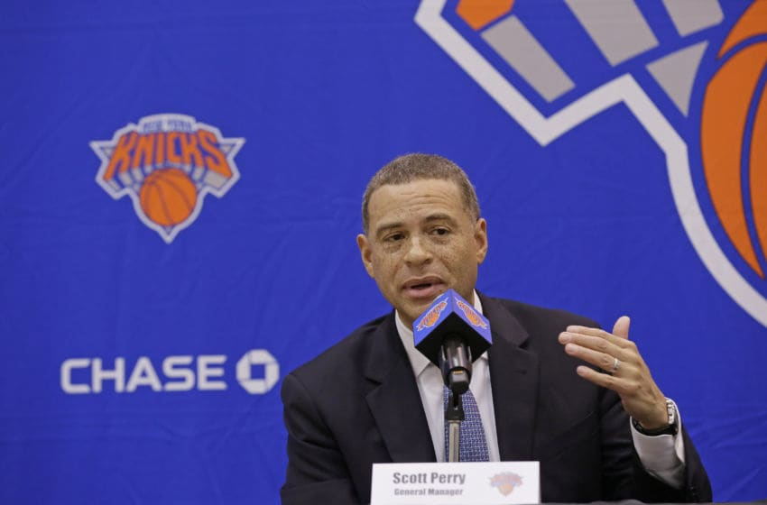 GREENBURG, NY - JULY 17: New York Knicks team President, Steve Mills and Jeff Hornacek of the New York Knicks introduce General Manager Scott Perry at a pess conference at the at Knicks Practice Center July 17, 2017 in Greenburg, New York. NOTE TO USER: User expressly acknowledges and agrees that, by downloading and/or using this photograph, user is consenting to the terms and conditions of the Getty Images License Agreement. Mandatory Copyright Notice: Copyright 2017 NBAE (Photo by Steven Freeman/NBAE via Getty Images)