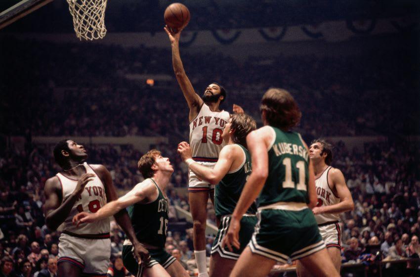 NEW YORK - 1973: Walt Frazier #10 of the New York Knicks shoots a layup against the Boston Celtics during the Eastern Conference Finals played in 1973 at Madison Square Garden in New York, New York. Copyright 1973 NBAE (Photo by Dick Raphael/NBAE via Getty Images)