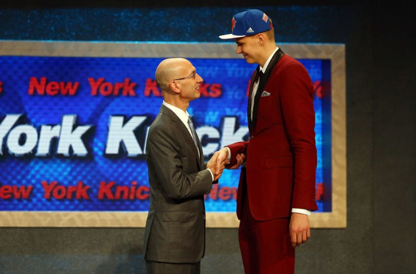 NEW YORK, NY - JUNE 25: Kristaps Porzingis meets with Commissioner Adam Silver after being selected fourth overall by the New York Knicks in the First Round of the 2015 NBA Draft at the Barclays Center on June 25, 2015 in the Brooklyn borough of New York City. (Photo by Elsa/Getty Images)