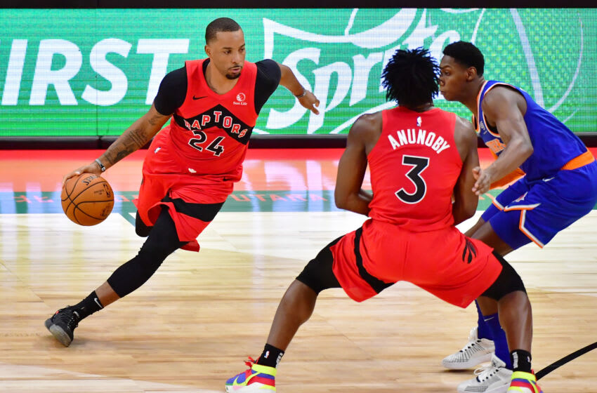 TAMPA, FLORIDA - DECEMBER 31: Norman Powell #24 of the Toronto Raptors drives to the basket during the second half against the New York Knicks at Amalie Arena on December 31, 2020 in Tampa, Florida. NOTE TO USER: User expressly acknowledges and agrees that, by downloading and or using this photograph, User is consenting to the terms and conditions of the Getty Images License Agreement. (Photo by Julio Aguilar/Getty Images)