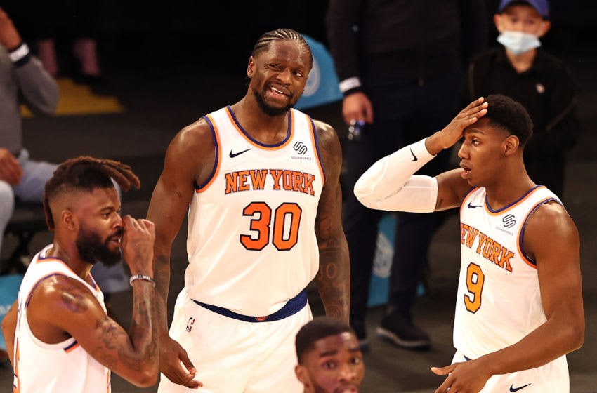 NEW YORK, NEW YORK - MARCH 21: Julius Randle #30 Nerlens Noel #3 and RJ Barrett #9 of the New York Knicks react after Randle is called for a foul in the final seconds of the overtime period against the Philadelphia 76ers at Madison Square Garden on March 21, 2021 in New York City.The Philadelphia 76ers defeated the New York Knicks 101-100 in overtime.NOTE TO USER: User expressly acknowledges and agrees that, by downloading and or using this photograph, User is consenting to the terms and conditions of the Getty Images License Agreement. (Photo by Elsa/Getty Images)