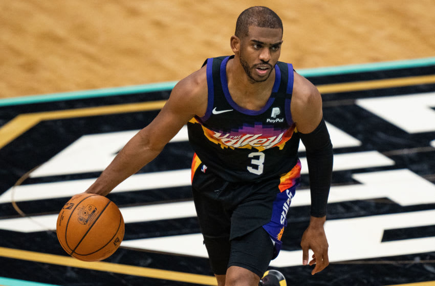 CHARLOTTE, NORTH CAROLINA - MARCH 28: Chris Paul #3 of the Phoenix Suns brings the ball up court against the Charlotte Hornets during their game at Spectrum Center on March 28, 2021 in Charlotte, North Carolina. NOTE TO USER: User expressly acknowledges and agrees that, by downloading and or using this photograph, User is consenting to the terms and conditions of the Getty Images License Agreement. (Photo by Jacob Kupferman/Getty Images)