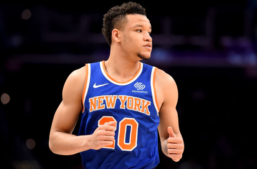 WASHINGTON, DC - DECEMBER 28: Kevin Knox II #20 of the New York Knicks looks on against the Washington Wizards during the first half at Capital One Arena on December 28, 2019 in Washington, DC. NOTE TO USER: User expressly acknowledges and agrees that, by downloading and or using this photograph, User is consenting to the terms and conditions of the Getty Images License Agreement. (Photo by Will Newton/Getty Images)
