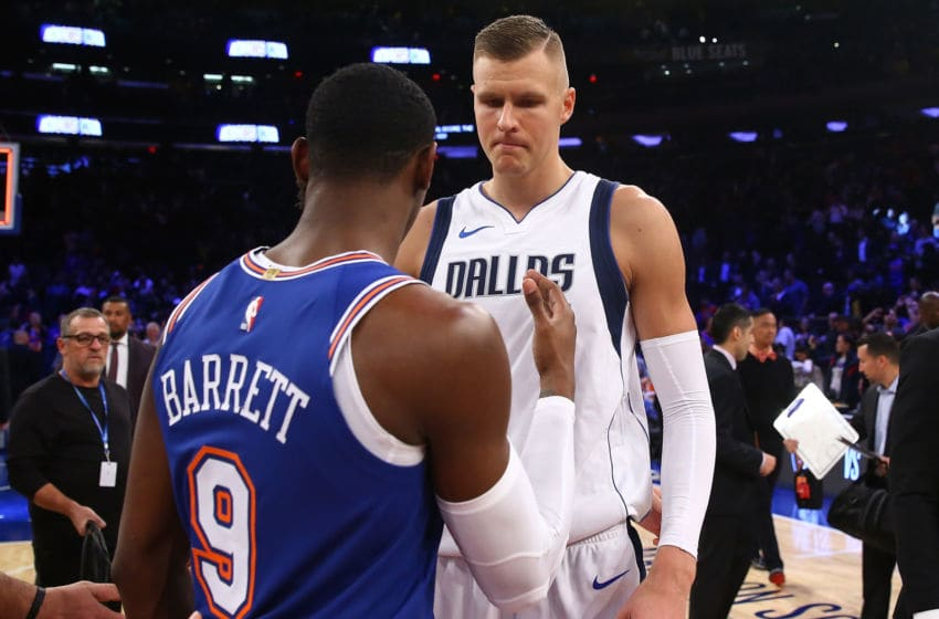 NEW YORK, NEW YORK - NOVEMBER 14: Kristaps Porzingis #6 of the Dallas Mavericks and RJ Barrett #9 of the New York Knicks shake hands following the game at Madison Square Garden on November 14, 2019 in New York City. New York Knicks defeated the Dallas Mavericks 106-103. NOTE TO USER: User expressly acknowledges and agrees that, by downloading and or using this photograph, User is consenting to the terms and conditions of the Getty Images License Agreement. (Photo by Mike Stobe/Getty Images)
