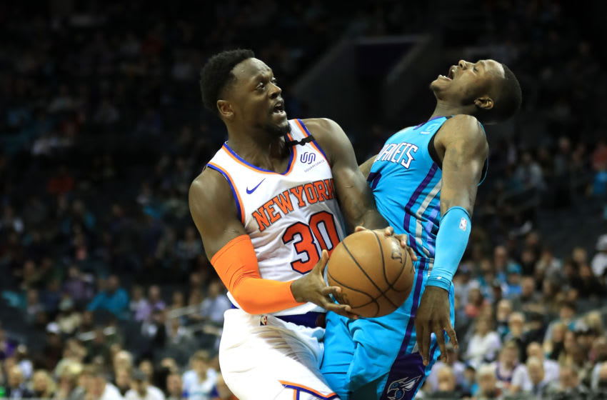 CHARLOTTE, NORTH CAROLINA - FEBRUARY 26: Julius Randle #30 of the New York Knicks collides with Terry Rozier #3 of the Charlotte Hornets during their game at Spectrum Center on February 26, 2020 in Charlotte, North Carolina. NOTE TO USER: User expressly acknowledges and agrees that, by downloading and or using this photograph, User is consenting to the terms and conditions of the Getty Images License Agreement. (Photo by Streeter Lecka/Getty Images)