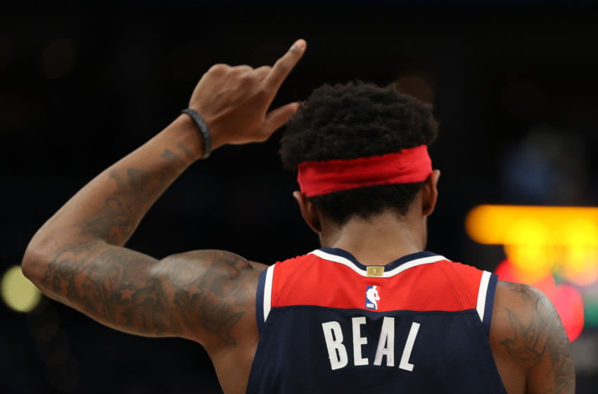 WASHINGTON, DC - MARCH 10: Bradley Beal #3 of the Washington Wizards celebrates against the New York Knicks at Capital One Arena on March 10, 2020 in Washington, DC. NOTE TO USER: User expressly acknowledges and agrees that, by downloading and or using this photograph, User is consenting to the terms and conditions of the Getty Images License Agreement. (Photo by Patrick Smith/Getty Images)