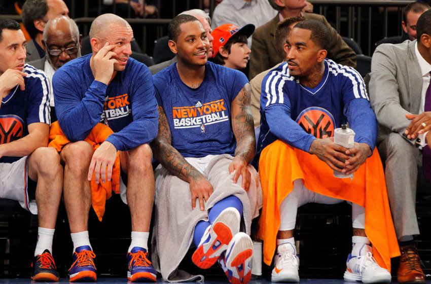 NEW YORK, NY - APRIL 23: (NEW YORK DAILIES OUT) (L-R) Jason Kidd #5, Carmelo Anthony #7 and J.R. Smith #8 of the New York Knicks look on against the Boston Celtics during Game Two of the Eastern Conference Quarterfinals of the 2013 NBA Playoffs on April 23, 2013 at Madison Square Garden in New York City. The Knicks defeated the Celtics 87-71. NOTE TO USER: User expressly acknowledges and agrees that, by downloading and/or using this Photograph, user is consenting to the terms and conditions of the Getty Images License Agreement. (Photo by Jim McIsaac/Getty Images)