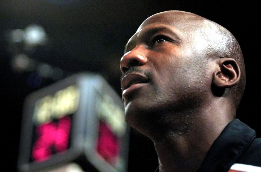 NEW YORK, UNITED STATES: Washington Wizards forward Michael Jordan looks towards the rafters during pre-game ceremonies at the start of his first game, against the New York Knicks, since returning to the NBA for the second time 30 October, 2001 at Madison Square Garden in New York City. AFP PHOTO/Matt CAMPBELL (Photo credit should read MATT CAMPBELL/AFP via Getty Images)