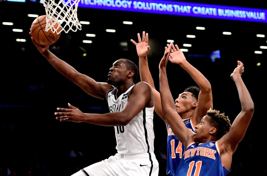 NEW YORK, NY - OCTOBER 03: Theo Pinson #10 of the Brooklyn Nets attempts a lay up past Allonzo Trier #14 and Frank Ntilikina #11 of the New York Knicks during a preseason game at Barclays Center on October 3, 2018 in New York City. NOTE TO USER: User expressly acknowledges and agrees that, by downloading and or using this photograph, User is consenting to the terms and conditions of the Getty Images License Agreement. (Photo by Steven Ryan/Getty Images)